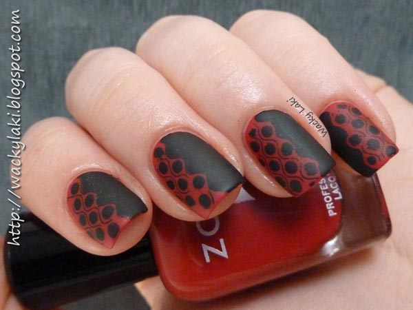 stamped red on black matte nails