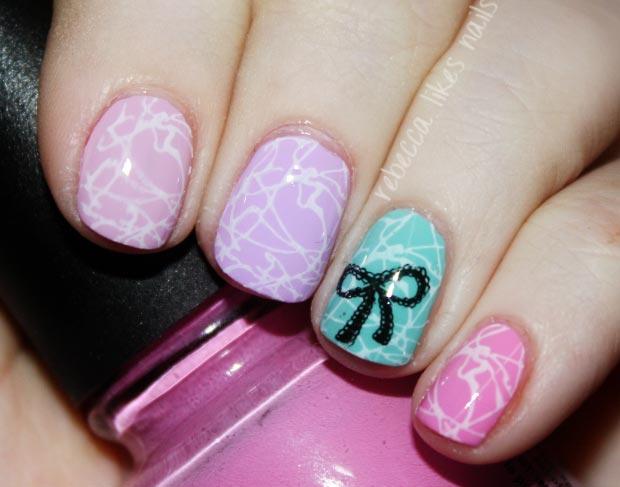 stamped splatter bow pastel nails