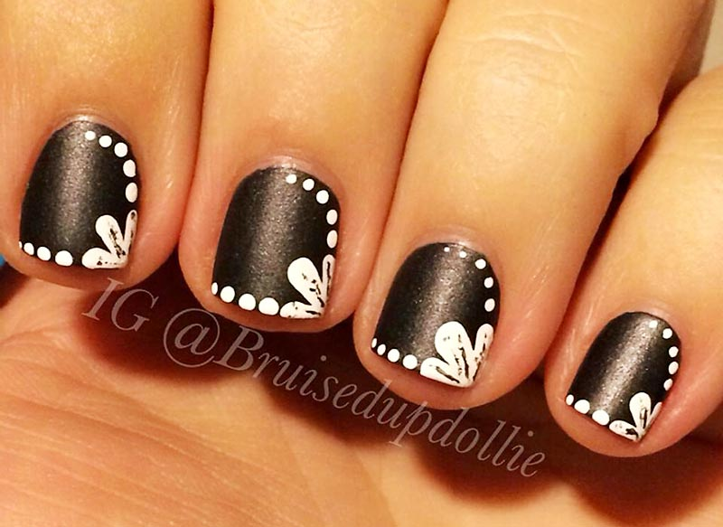 white dotted framed black nails