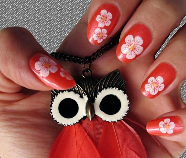 white flowers on coral nails