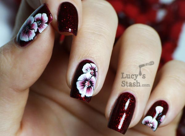 white flowers shimmer deep red nails
