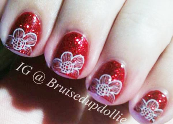 white flowers stamped red glitter nails