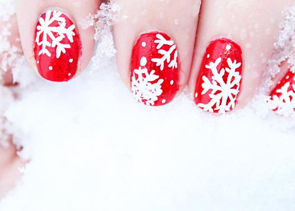 white snowflakes red nails