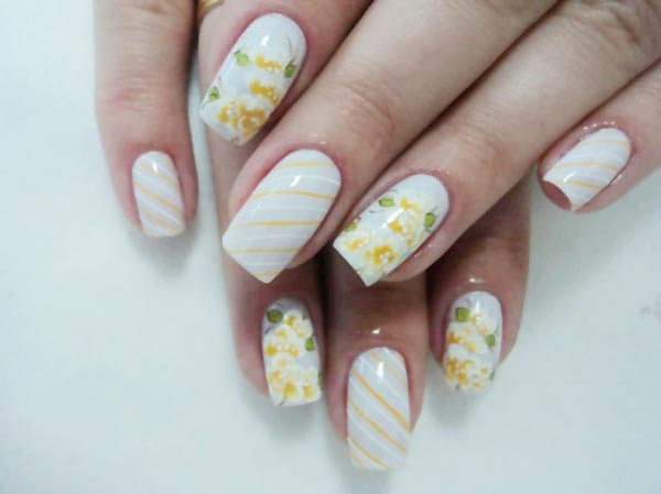 white yellow stripes flowers spring nails