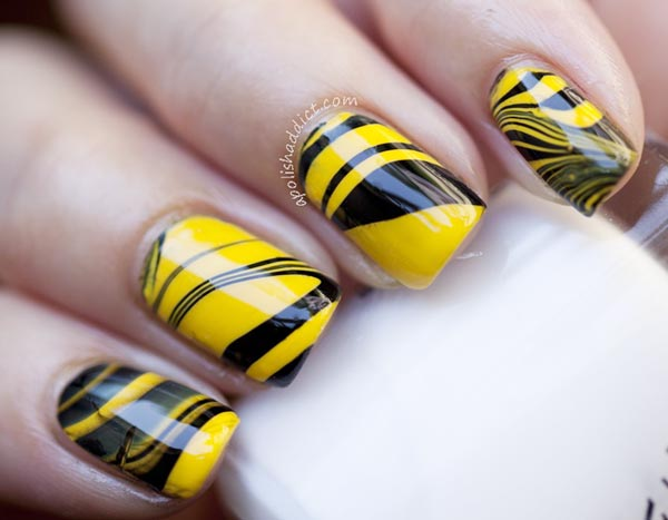 yellow black marbled nails