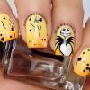 yellow orange gradient skellington halloween nails