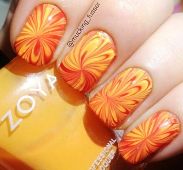yellow red spring summer marbled nails