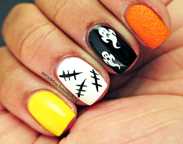 yellow white black orange halloween nails