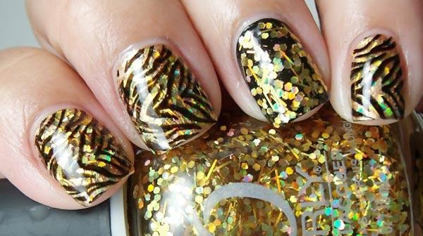 zebra stamped over gold glitter nails